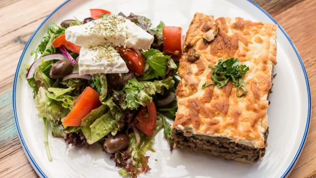 Meat-free moussaka and Greek salad with vegan feta.