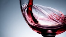 Stream of wine being pouring into a glass closeup. Downloaded under the Good Food team account (contact syndication for ...