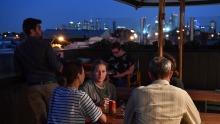Peak Brunswick: Carousing vegans against a backdrop of city lights atop the Cornish Arms.