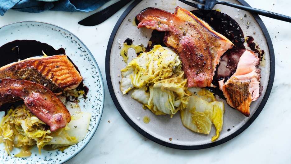 Roast salmon with red wine sauce and braised cabbage.