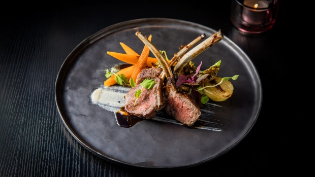 Char-grilled lamb rack with honey carrots, brussels sprouts and sweet miso mint sauce.