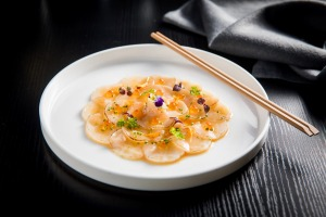 Scallop carpaccio, torched and thinly sliced with butter soy.