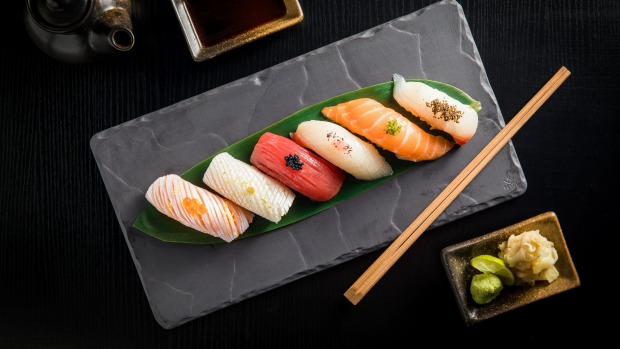 Enjoy some sushi nigiri with a lychee gin and tonic.