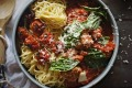 Spaghetti and meatballs served with slow-roasted cherry tomatoes and fontina cheese.