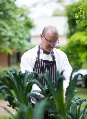 Chef and Japanphile Michael Ryan picks kale at his Beechworth restaurant, Provenance.