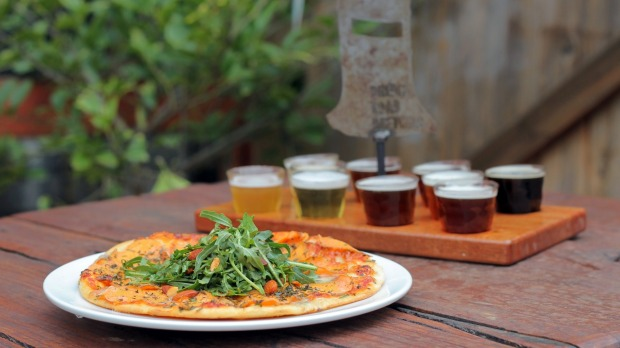 A tasting paddle of beers from Bridge Road Brewers and a sweet potato and gorgonzola pizza.