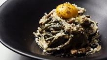 Charcoal bucatini, smoked mushroom pancetta, vegan 'egg' yolk and plant-based parmesan at Mark and Vinny's Spaghetti and ...