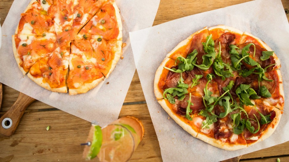 Smoked salmon and prosciutto and rocket pizzas at Flatiron Side Door wine bar, Kew.
