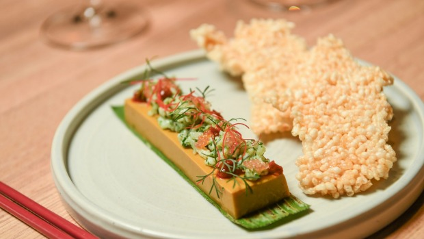 Nguyen's play on otak otak is a coconutty curried crab parfait.