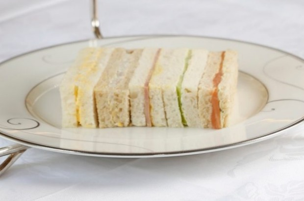 Neatly trimmed ribbon sandwiches on a tiered tea stand at Melbourne's Windsor Hotel.