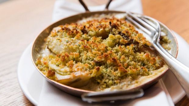 Fennel baked with milk and toasted breadcrumbs.