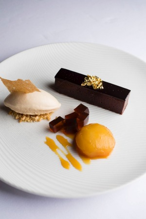 A signature dish as est.: Valrhona chocolate torte, Pedro Ximenez jelly, caramel poached pear and hazelnut praline ice-cream.