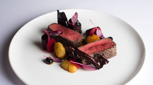 Juniper-crusted vension saddle, beetroot, boudin noir, roasted chestnuts, cocoa paper at est.