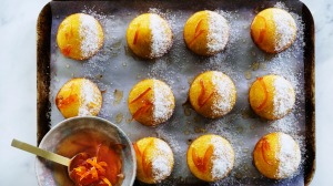 Orange coconut and semolina cakes with orange blossom syrup and marmalade glaze.