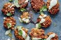 Golden cauliflower chia fritters with green tahini dip.