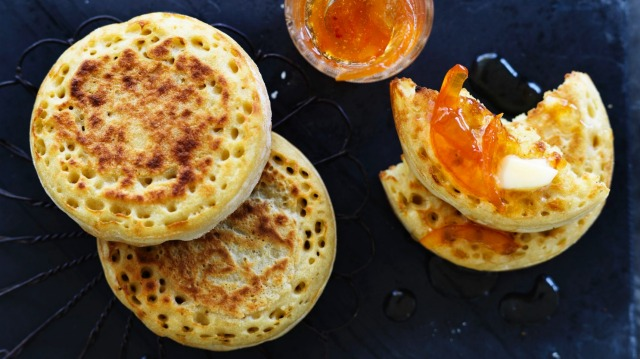 Buttered crumpets with grapefruit and cardamom marmalade (recipe below).