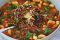 Minestrone with cheese-stuffed meatball.