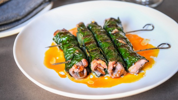 Pork scotch fillet with prune wrapped in betel leaves.