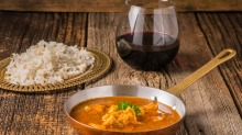 Shiraz goes surprisingly well with medium-hot Indian curries.