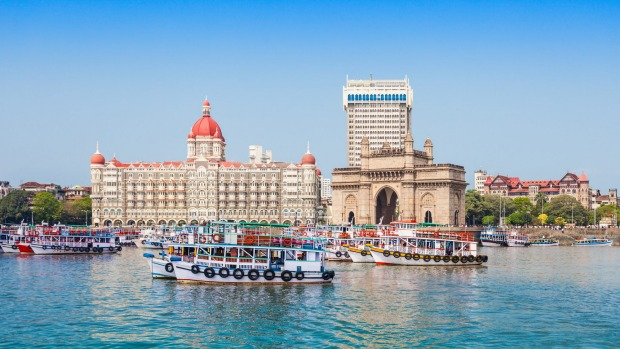 The Taj Mahal Hotel and Gateway of India seen from Mumbai Harbour.