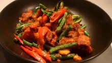 Must-try: Wok-fried pork belly with red curry paste, beans and kaffir lime leaf.