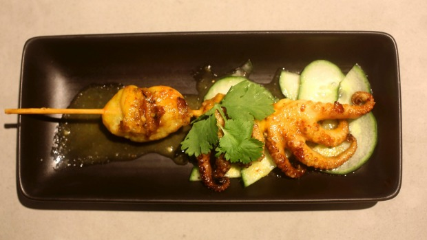 Grilled marinated baby octopus skewer with nahm jim sauce.