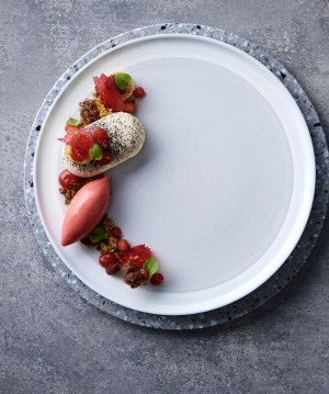 Main Ridge goat's cheesecake with strawberries, balsamic, pistachio and strawberry sorbet.
