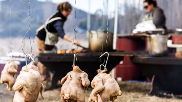 A junkyard barbecue, complete with chickens hanging from the hills hoist, at the Huon Valley Mid-Winter Festival.