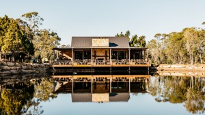 Waterside dining: The sandstone homestead is perched on a dam.