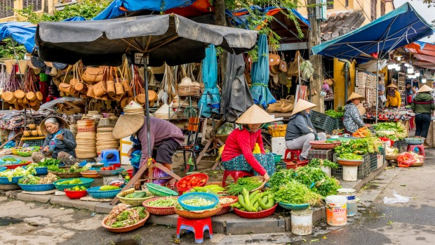 Fresh vegetables in a traditional street market in Hoi An.