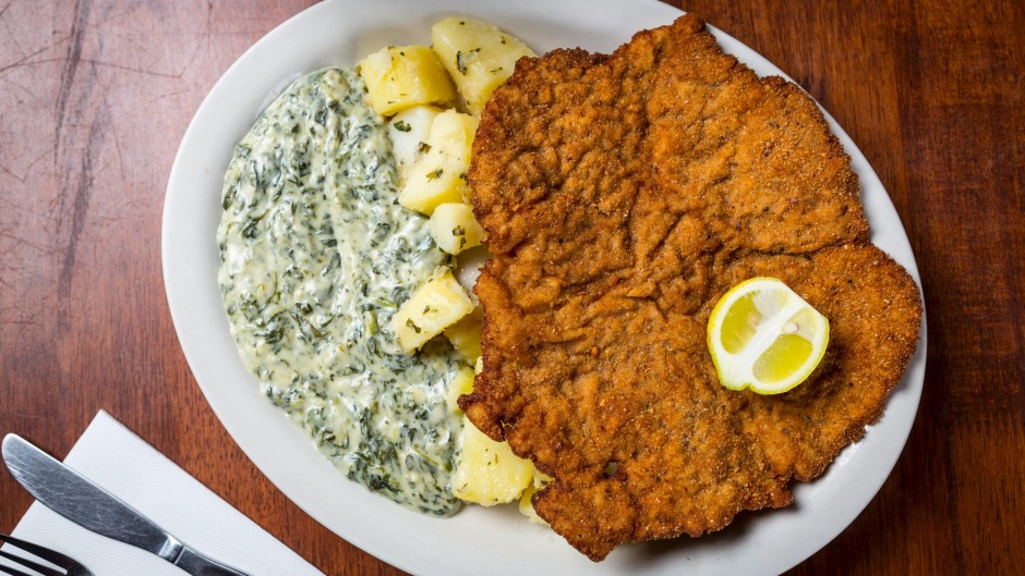 The infamous wiener schnitzel served with potatoes and creamed spinach.