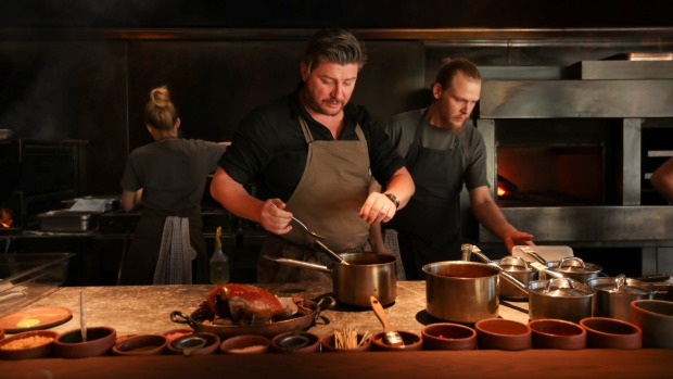 Scott Pickett at the helm of his fire-powered kitchen.