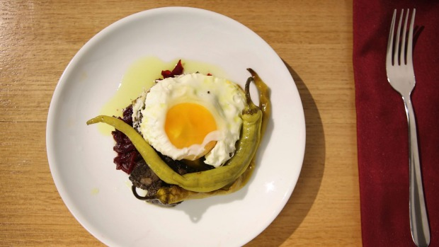 Pickled beetroot and fried egg dish.