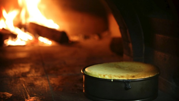 A baked cheescake in the wood-fired oven.