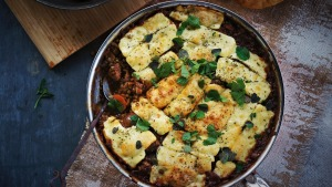 Sausage and lentil and casserole covered with haloumi cheese.