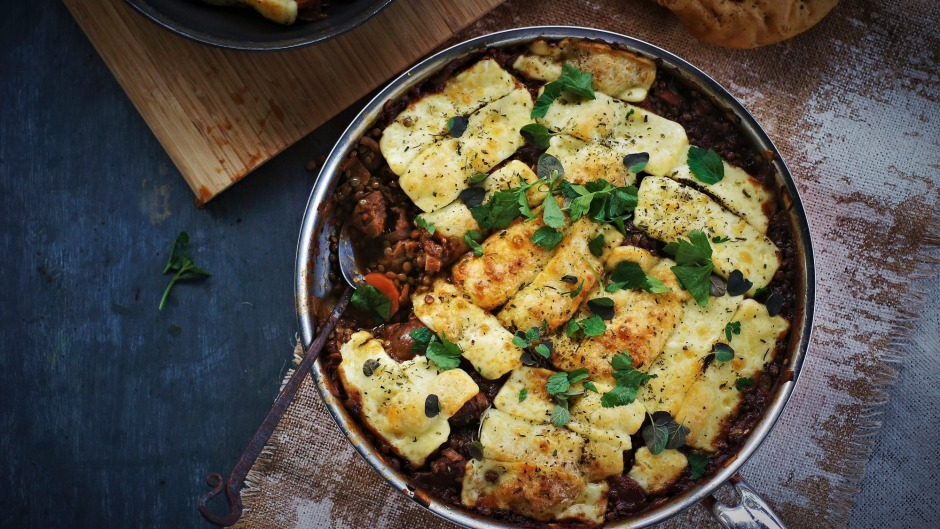 Sausage and lentil stew with grilled haloumi.
