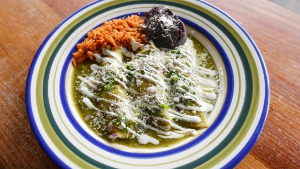 Chicken enchiladas with green mole sauce.