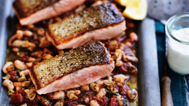 Neil Perry's crispy skin salmon with braised white beans.