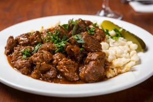 Go-to dish: Hungarian goulash with nokedli and dill pickle.