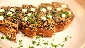 Next-level prawn toast with sesame seeds and yuzu mayonnaise.