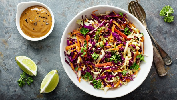 Don't like the smell of cooked cabbage? Try Asian coleslaw with sesame and peanut butter dressing.