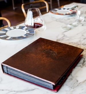 Wine lists range from one page to hefty leather-bound tones, like Ten Minutes by Tractor's list.