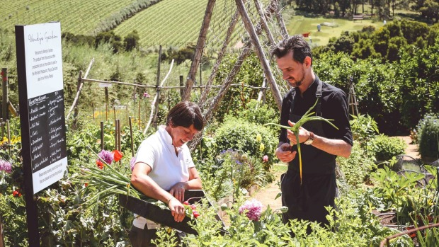 Bursting into bloom: Head gardener Julie Bennett and chef Gerard Phelan in Montalto Estate's three-hectare garden.