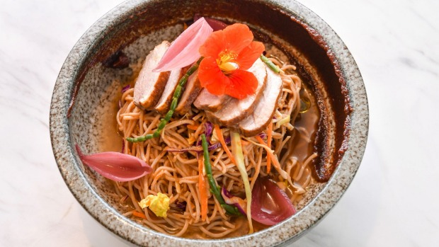 Signature dish The Chen - tea-smoked duck with soba noodles and samphire.