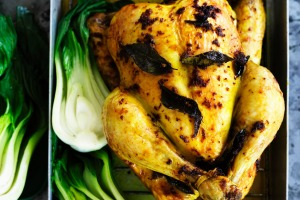 Salt-roasted chicken with turmeric and ginger.