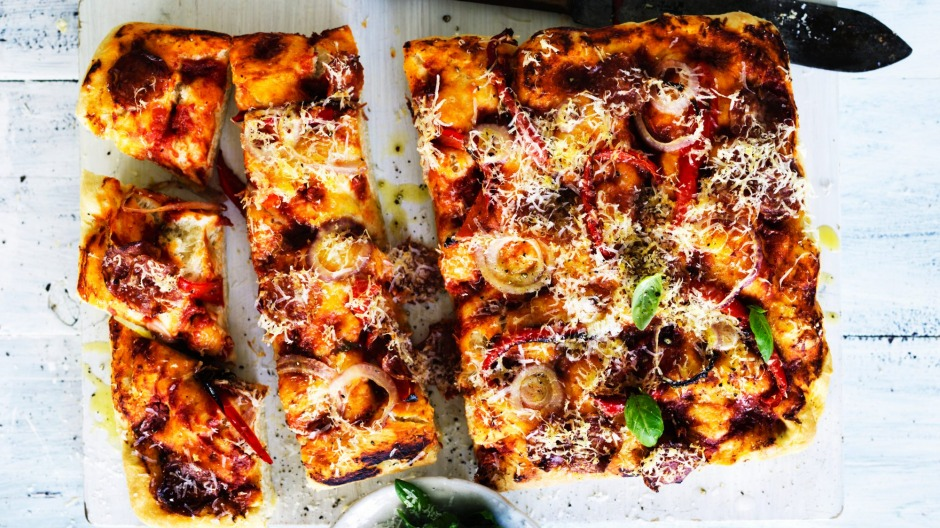 When in Rome (or at home) … take a tip from the Italian home cook and make a tray-style pizza.