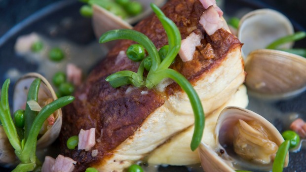 Freshly caught fish with surf clams, bacon and peas.