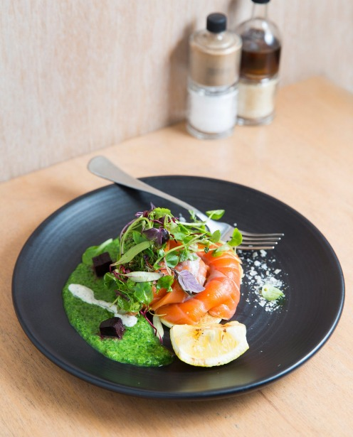 Citrus and herb cured salmon served with cucumber blinis, pea puree and beetroot jelly at Industry Beans in Fitzroy.