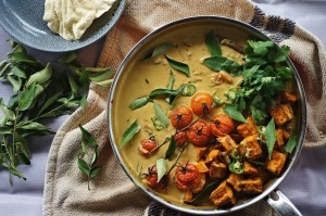 Vibrant vegan sweet potato, cherry tomato and tamarind curry.