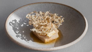 Go-to dish: Smoked pig jowl, fan shell razor clams, shiitake, sea cucumber crackling.